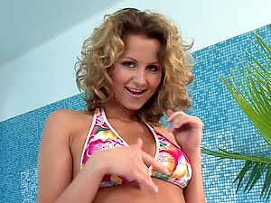 Lustful curly chick pleases both her holes in the bathroom