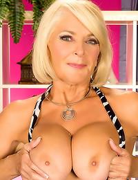 Mature does hot striptease