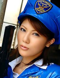 Asian police babe with gun