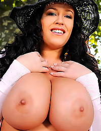 Curly hair curvy girl outdoors