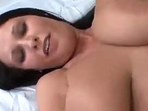 Busty brunette babe Bella Blaze tit fucks Asian guy