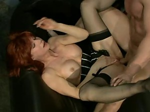 Busty Redhead Gets A Hardcore Fuck While She Wears Lingerie