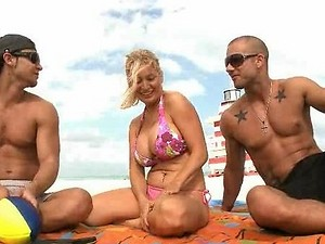Hot Blonde MILF Meets Two Young Guys on the Beach