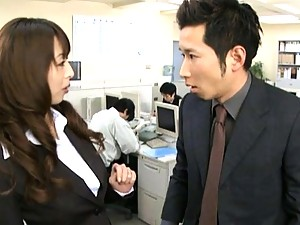 Japanese AV Model get teased in the office with a vibrator