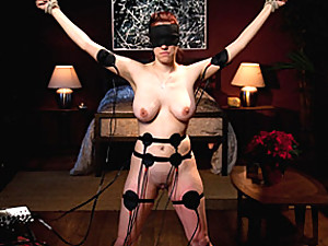 Electro pads on busty bondage girl