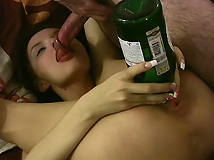 Look at what is sticking from her slit - it's a bottle!
