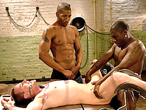 Bound white guy takes black