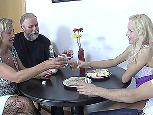 His girlfriend shares a few drinks with his family and soon she eats wet mom pussy