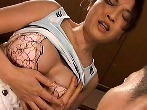 Japanese AV Model pulls down her bra to expose her big boobs