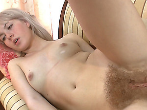 Nomi feels so sexy putting on her make up. She can't help herself, so she strips out of her clothes and plays with her hairy pussy! She is such a hairy girl fingering herself.