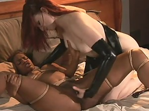 Horny Bondage Lesbians With a Latex Fetish Have Some Interracial Fun