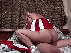 Perverse blonde cheerleader Katie Morgan riding a monster dick
