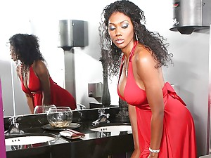 Black pornstar in sexy red dress