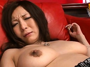 Ayami?s shaved pussy is fucked by a big dildo to make her wet