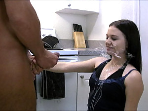 Brandi strokes a long cock and makes him cum